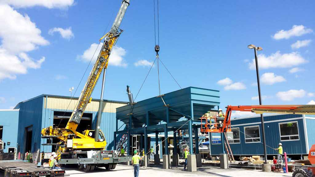 Crane lifting large sifter