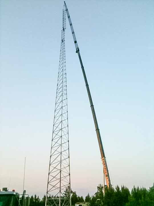 Crane placing high tower