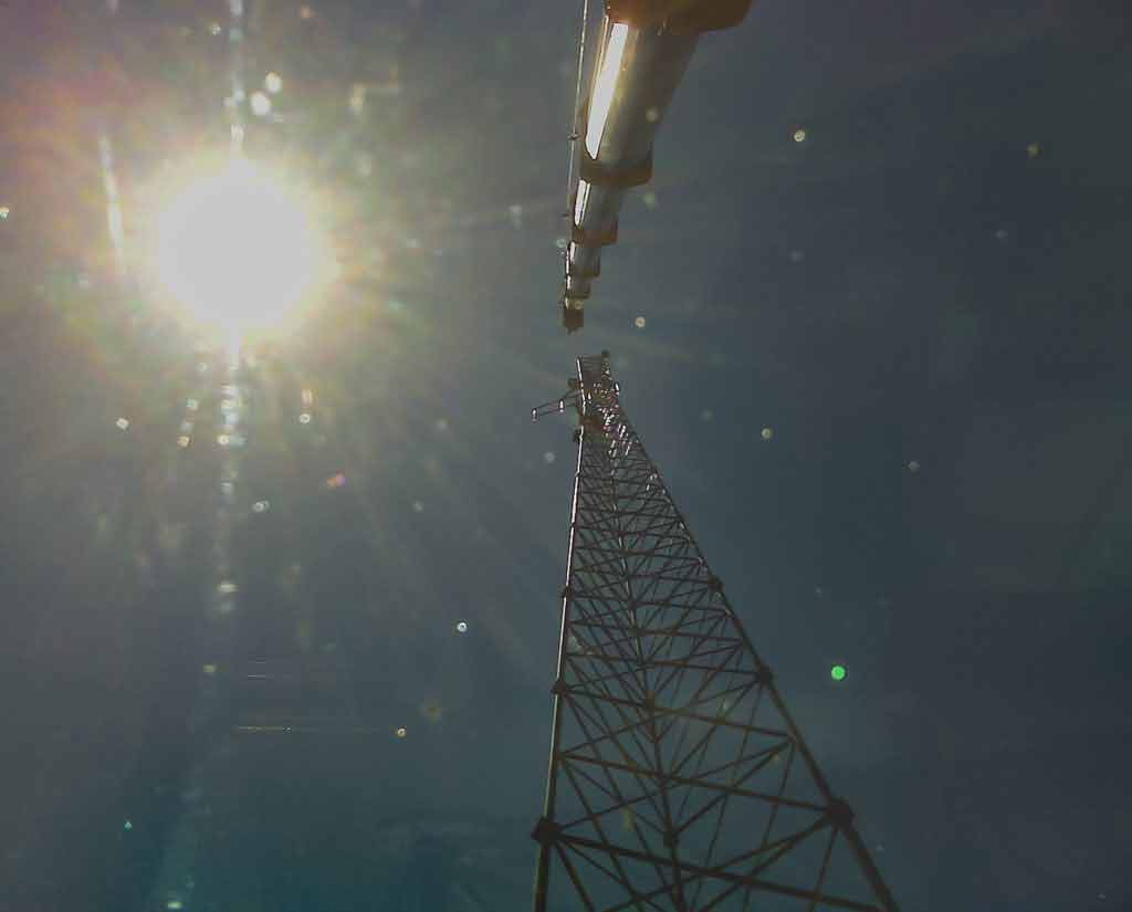 Crane placing cell tower