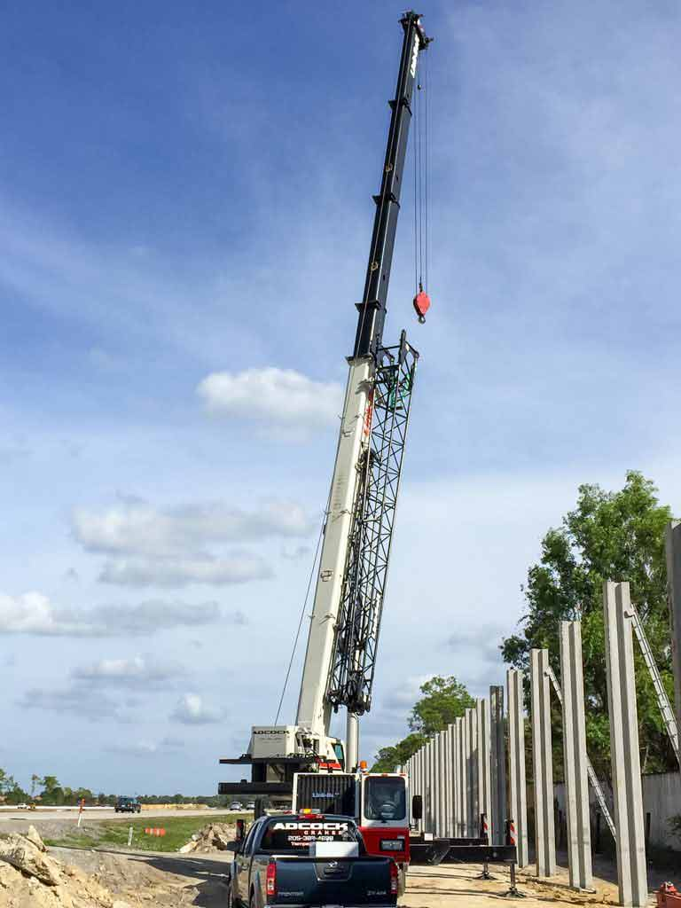 Crane placing concrete pillars